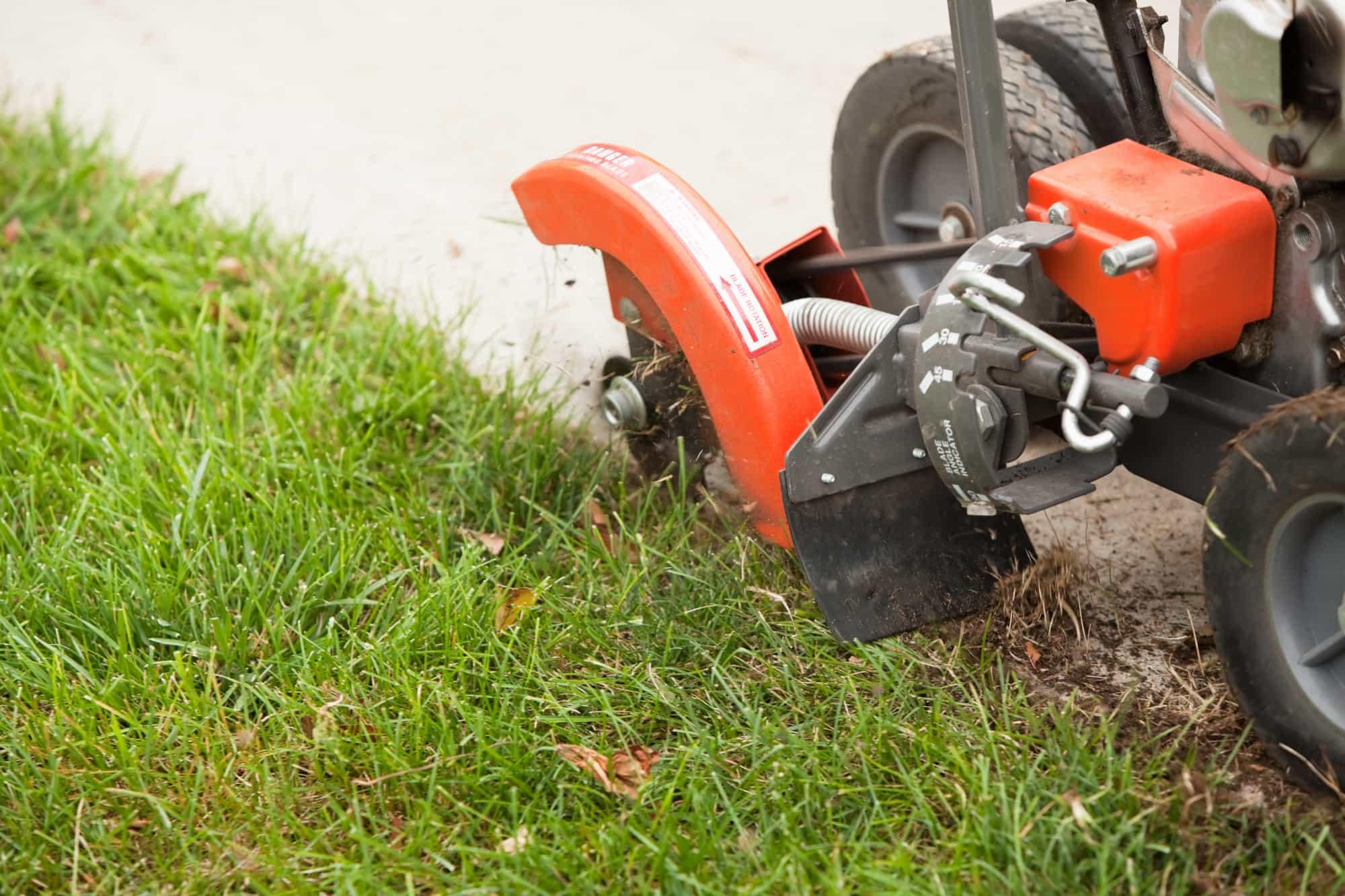 lawn professional using a lawn edging machine