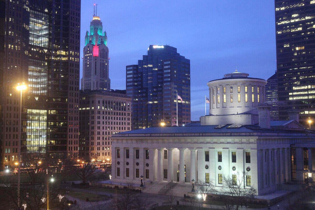 Downtown Columbus, Ohio buildings lit up at dusk