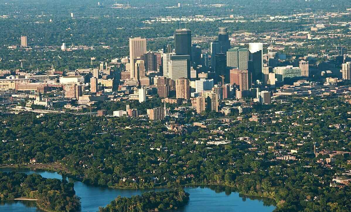 Aerial view of Minneapolis including the city skyline and the trees surrounding the city