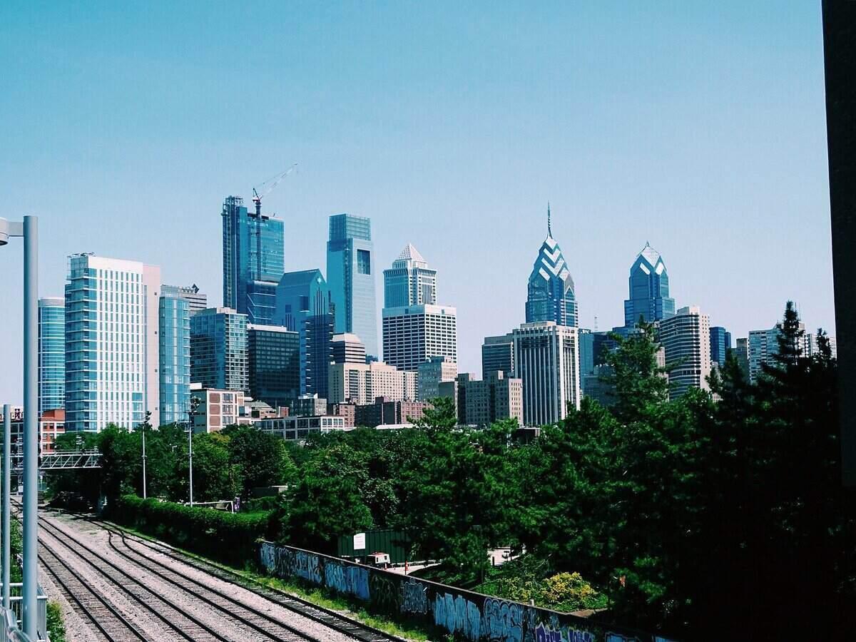 Philadelphia, PA skyline and train tracks