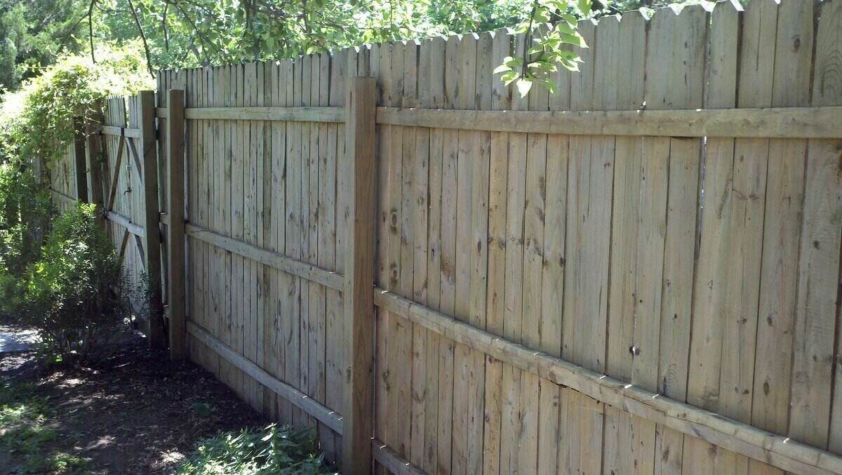Freshly power washed wooden fence