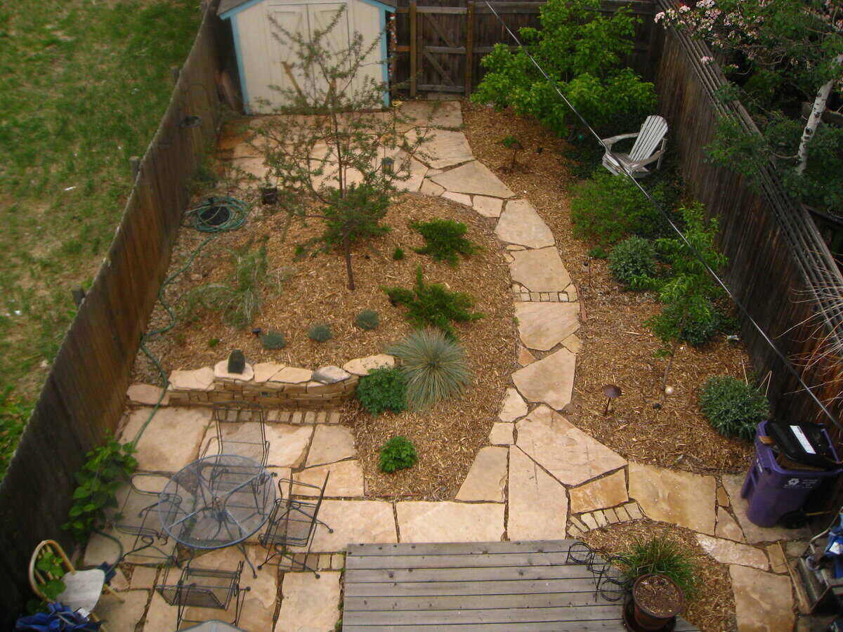 Aerial shot of a backyard with hardscape and xeriscape design